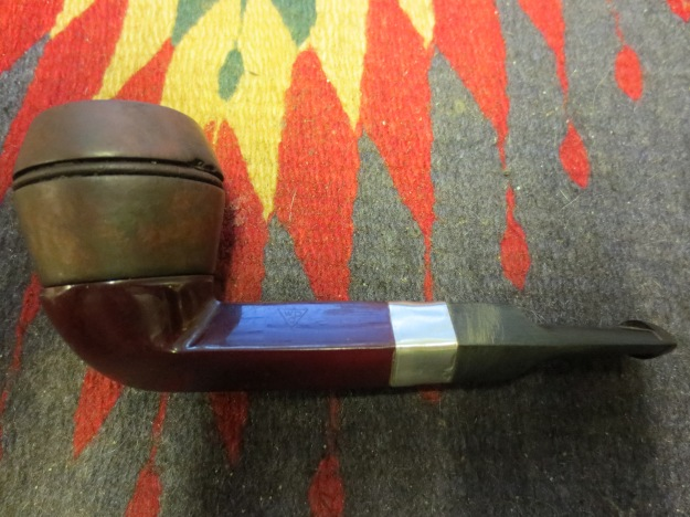 Left side of the pipe with a hand buff on the newly stained bowl.